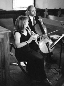 Flute and Cello Playing Music at Wedding